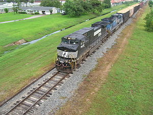 Norfolk Southern Engine along KCS rail.