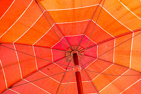 Old red beach umbrella