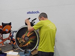 Ottobock - An Ottobock technician repairs a wheelchair at the 2016 Paralympic Games in Rio de Janeiro