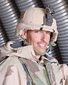 Head and shoulders of smiling man in circa 2000 U.S. Army battle dress.