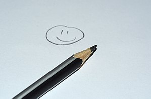 Pencil with a smiley face on paper.JPG