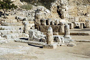 Heraion of Perachora - The triglyph and metope altar from the south; beyond the altar is the western end of the L-shaped stoa.