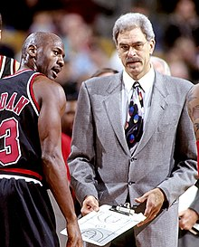 a421ea49fd0 Bulls head coach Phil Jackson consulting Michael Jordan in 1997