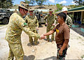 Philippine Army Capt. Felipe Estrada, right, greets Australian Army Lt. Col. Rod Long at a school construction site during Balikatan 2013 in Pugad Lawin, Philippines, April 6, 2013 130406-N-VN372-083.jpg