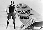 Pilot Bill Lindley with his airplane (4203509136).jpg