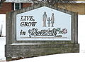 Pleasantville Iowa 20080111 Live Grow Sign.JPG