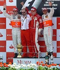 Left to right: Fernando Alonso, Gilles Simon, Kimi Räikkönen and Lewis Hamilton on the podium of the 2007 British Grand Prix