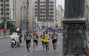 Prague Half Marathon - Winner Zersenay Tadese and four other runners crossing the Čechův most bridge a few minutes before finishing the 2013 Prague Half Marathon