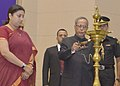 Pranab Mukherjee lighting the lamp on the occasion of the International Literacy Day celebrations, in New Delhi on September 08, 2014. The Union Minister for Human Resource Development, Smt. Smriti Irani is also seen.jpg