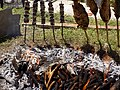 Preparation of smoked carp at the Carp Day Festival in Plavnica, Montenegro 02.jpg