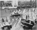President Truman and Vice President Alben Barkley ride in a limousine to the reviewing stand for the inaugural... - NARA - 200040.tif