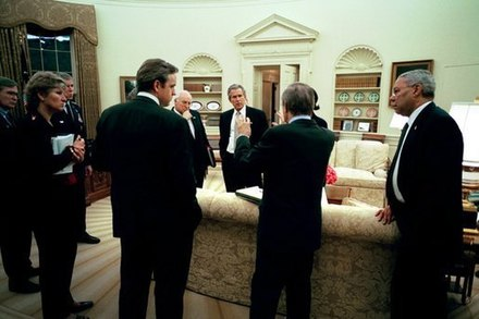 U.S. President George W. Bush meets with his top advisors on 19 March 2003 just before the invasion Prewar-meeting.jpg