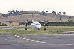 QantasLink (VH-QOK) Bombardier DHC-8-402Q taxiing at Wagga Wagga Airport.jpg