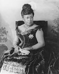 Queen Kapiʻolani wearing her peacock feathered dress
