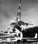 RA-5Cs RVAH-13 being hoisted on USS Kitty Hawk (CVA-63) 1965.jpg