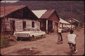RAND, WV., WITH MUCH OF ITS POPULATION LIVING IN POVERTY, HAS MANY UNPAVED ROADS, SUBSTANDARD HOUSES, AND JUNKED... - NARA - 551001.jpg