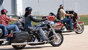 Types of motorcycles - Harley-Davidson cruisers and a touring bike (red)