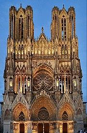 Notre-Dame de Reims façade, gothic stone cathedral against blue sky