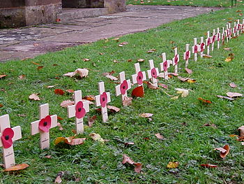Crosses with poppies in a churchyard. Image: Amanda Slater.