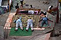 Resting pilgrims at Varanasi by the Ganges ghat.jpg