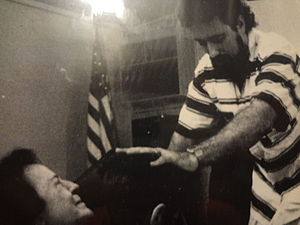 Faith healing - Richard Rossi prays for the sick at one of his faith healing services, September, 1990.