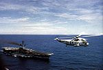 SH-3G of HC-1 flies near USS Hancock (CV-19) 1975.jpg