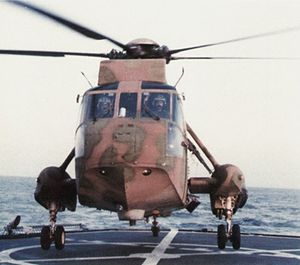 USS Peterson (DD-969) - A camouflaged CSAR SH-3H of HS-11 on Peterson off Libya, 1986.