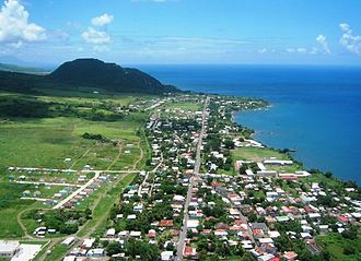 Sandy Point Town - Aerial view of the town of Sandy Point, showing the main road that encircles the island, and Brimstone Hill to the south