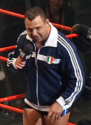 Santino Marella (Anthony Carelli) talking on t...