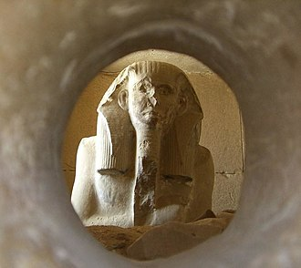 Serdab - The pharaoh Djoser's Ka statue peers out through the hole in his serdab, ready to receive the soul of the deceased and any offerings presented to it.