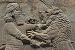Ashurbanipal kills a lion