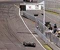 Sebastien Bourdais - NewmanHaas Racing takes the chequered flag at the 2003 Champcar London Trophy race (50813939807).jpg