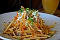 Shoestring fries, garlic, homemade blue cheese dressing, with some spicy sauce.jpg