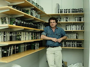 Picture of Simson Garfinkel surrounded by disk drives on shelves