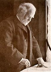An old bearded man drawing or measuring with a compass.