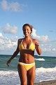 Smiling on the beach with a yellow bikini.jpg