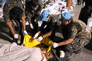 Brazilian Army - Haitian civilians receive assistance in a camp set up by the Brazilian Army in 2010 Haiti earthquake.