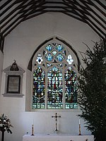 St James, East Window, near to Shere, Surrey, Great Britain. Inside Shere's historic parish church, obviously taken at Christmas time.