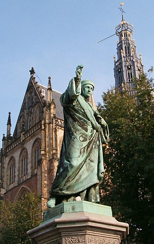 "Laurens Janszoon Coster - Statue of Laurens Janszoon Coster on the Grote Markt in Haarlem, where he was born. He holds the letter ""A"" up high."