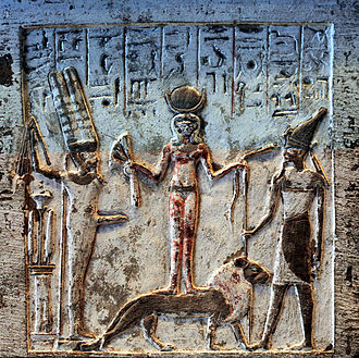 Resheph - Egyptian limestone stele depicting Qetesh on a lion flanked by Min (left) and  Resheph (right).