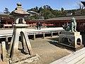 Stone lantern and guardian lion of Itsukushima Shrine.jpg