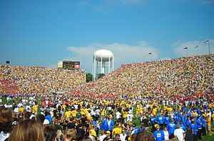 Iowa Hawkeyes - Fans rush the field after Iowa's 27–17 football victory over Iowa State on September 16, 2006.