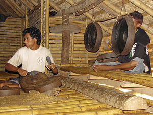Sumbanese traditional house - The left front post of a Sumbanese house is visible here complete with the special aperture where women passed rice to be offered to the marapu.