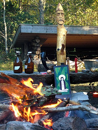Modern Paganism - Heathen altar for Haustblot in Björkö, Sweden-the larger wooden idol represents the god Frey.
