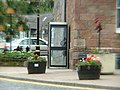 Telephone box at base of Dufftown Clock Tower - geograph.org.uk - 526644.jpg