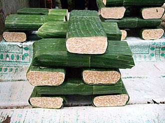 Tempeh - Fresh tempeh at the market, Jakarta, Indonesia – traditionally, tempeh is wrapped in banana leaves.
