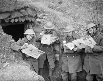 Blighty - British soldiers reading copies of Blighty magazine outside their dugout in France, December 1939.