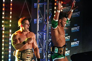 Jessie Godderz - Godderz with Robbie E (right) as the TNA World Tag Team Champions in April 2014.