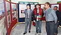 The Deputy Commissioner Lunglei, Shri Ashish Madhaorao More visiting the DAVP's Photo Exhibition at the Public Information Campaign, at Mualthuam North on November 27, 2014.jpg