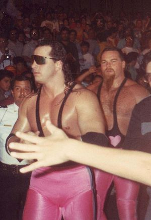 Bret Hart - Hart (left) with Jim Neidhart behind him as The Hart Foundation